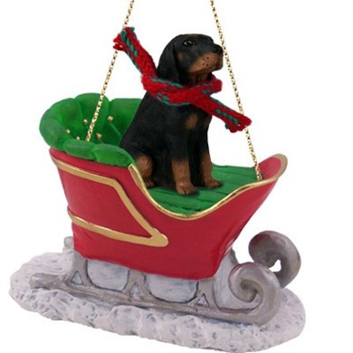 Raining Cats and Dogs | Black & Tan Coonhound Christmas Ornament with Sleigh